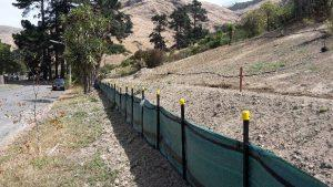 Silt fence installed across a loess hill slope in the Port Hills.